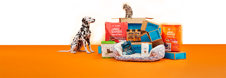 Dog and cat with pile of products